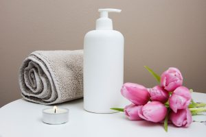 lotion towel and flowers