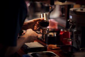 Close up Barista making cappuccino, bartender preparing coffee d