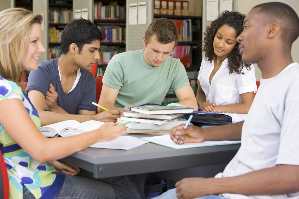 College students studying together in a library