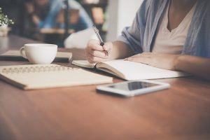 Power Thesaurus - writing in notebook